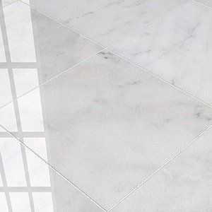 Carrara T Polished 24x24